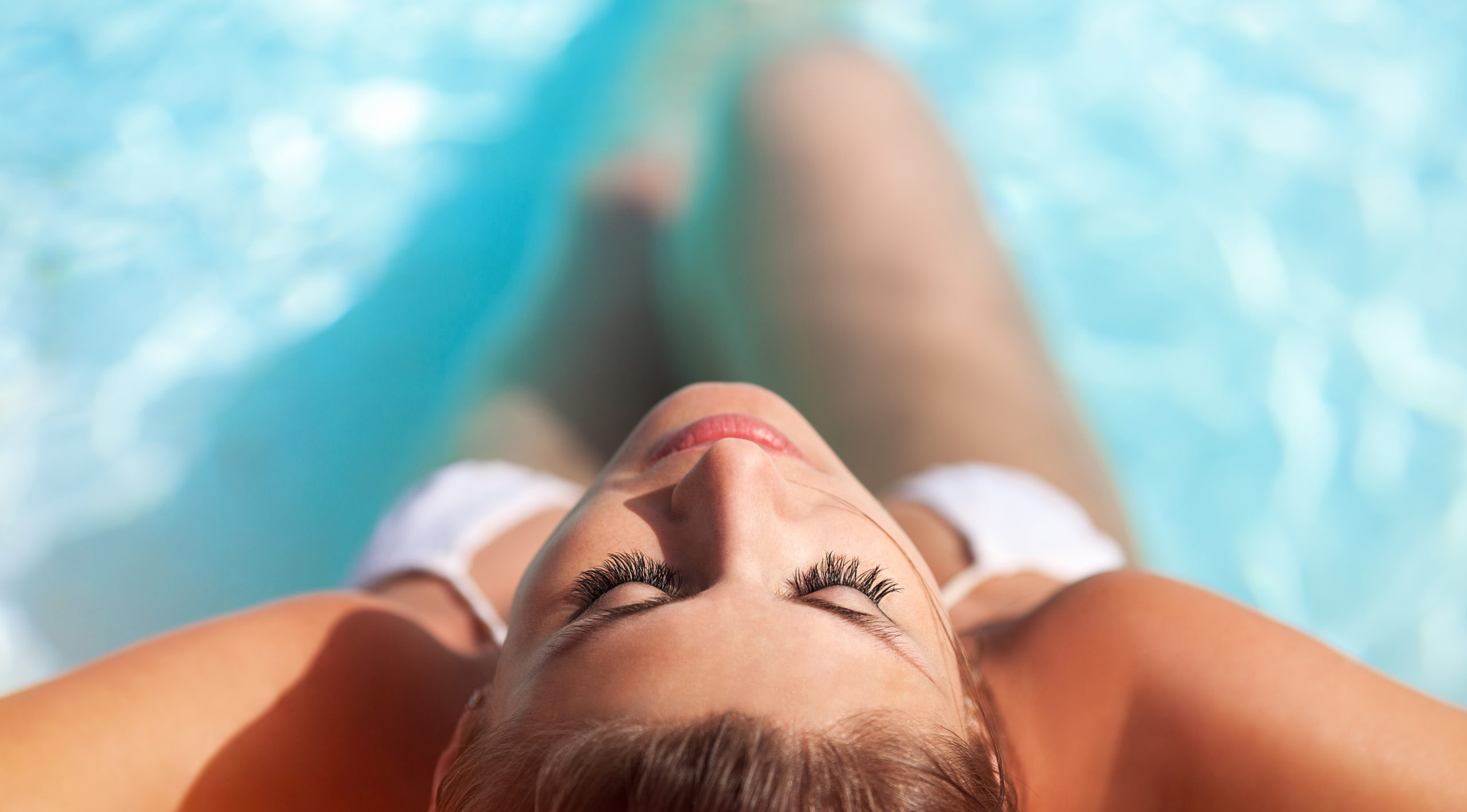 Portrait of a sexy girl in a swimming pool. Top view